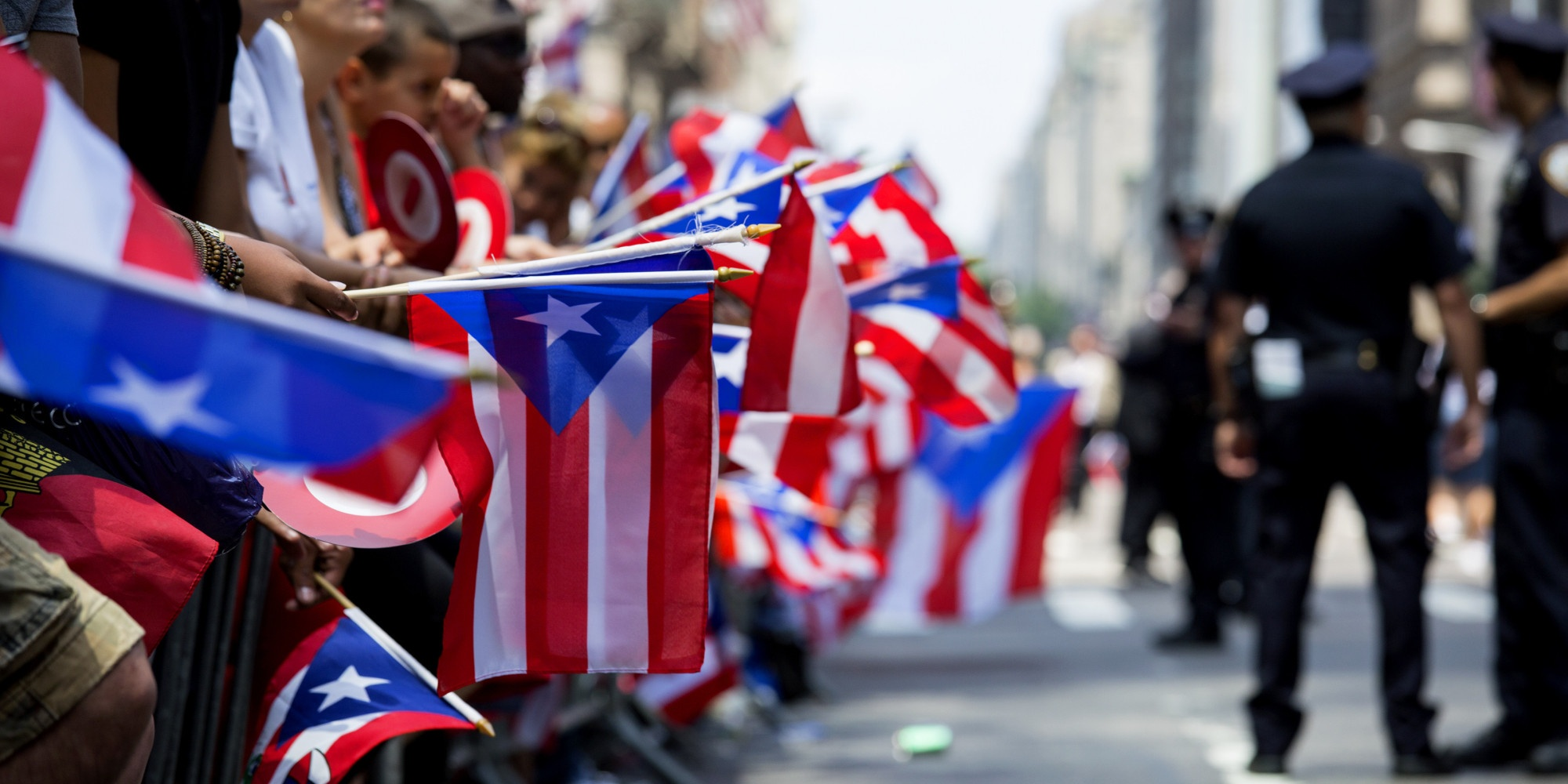 Fags of Puerto Rico are displayed along 5th Ave. during the National Puerto Rican Day Parade Sunday, June 9, 2013, in New York. (AP Photo/Craig Ruttle)